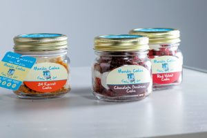 Image of three Mandie Cakes in jars.